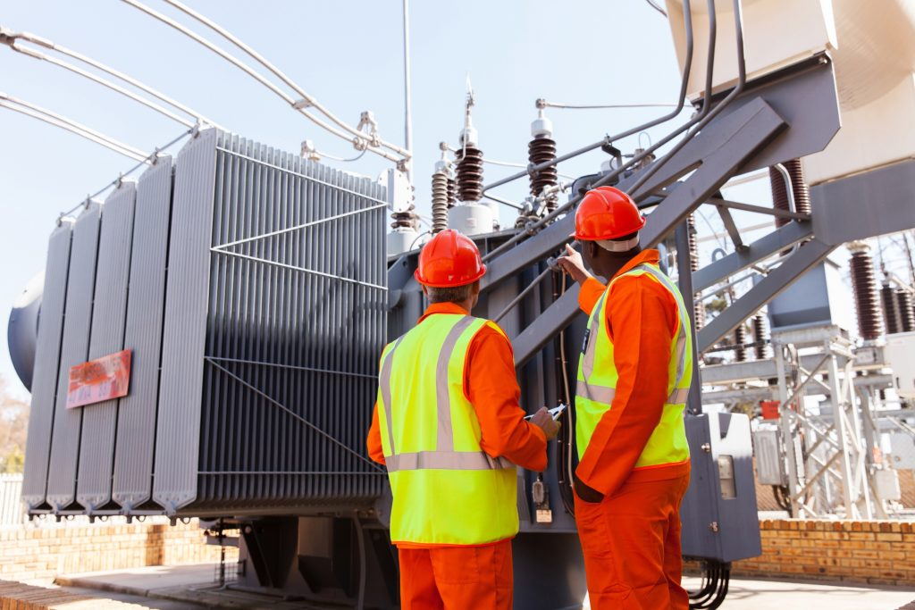 engineers inspecting transformer