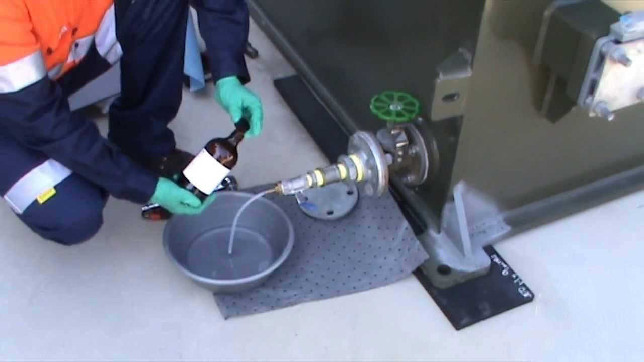 Taking samples for oil testing